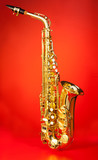 Fotoroleta Alto saxophone in full length on red background