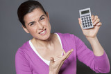 30s woman disappointed by figures shown on her calculator poster