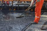 Crew placing mastic asphalt road poster