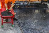 Crew placing mastic asphalt road and pea gravel surfacing poster