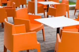 Modern furniture outdoor cafe terrace with orange chairs - Fine Art prints
