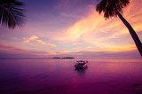 Fototapety Tropical island in the sunset with a boat