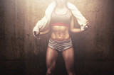 Fototapety Fitness woman after hard workout training holding white sports towel