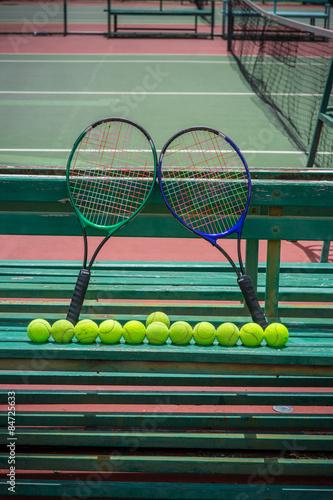 Fototapeta tennis racket and balls on the tennis court