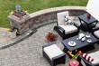 Brick paved patio with patio furniture