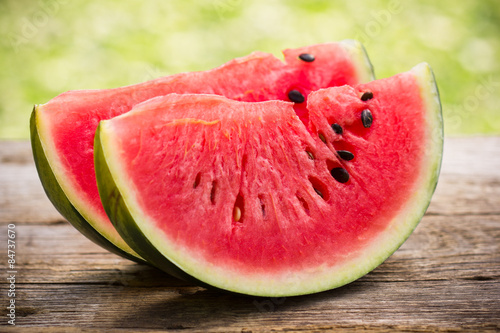 Watermelon slices on the wooden table Poster