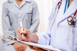 doctor writing patient's record after examine health