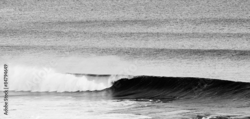 Closeup of a breaking wave in motion - 84794649