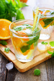 Fototapeta Cold orange drink with basil