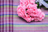pink carnation floral on ion violate cloth background poster