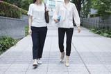 Women talking while walking
