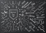 Hand drawn arrow icons set on black chalk board
