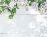Blooming lilac flowers on the old wooden table. - 84857299
