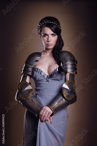 Poster portrait of a beautiful lady warrior, dark-haired girl in a gray