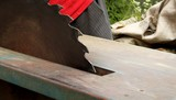 Man cuts wood on the circular saw. Violation of labor safety. poster