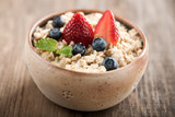 Breakfast oatmeal with milk and berries - 84913438