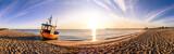Fototapety Boot am Strand Sonnenuntergang Panorama