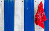 Red handkerchief hanging on blue and white wood background