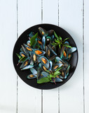scald mussel with thai sweet basil in black plate poster
