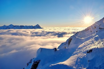 Winter mountain landscape with sea of clouds. Tatra Mountains in Poland.