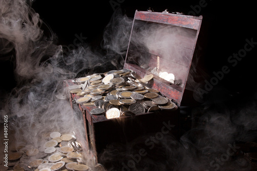 Poster Treasure chest filled with coin baht and fog. It seems a mystery