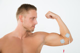 Man Having Electrotherapy Of Arm poster