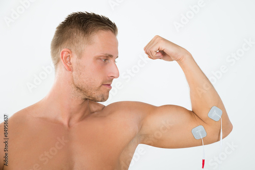 poster of Man Having Electrotherapy Of Arm