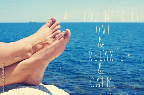 young man relaxing on the sea and text all you need is love and Poster