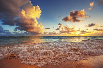 Sunrise on the beach of Caribbean sea © ValentinValkov