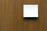 Post it note against wooden surface. - 84973812