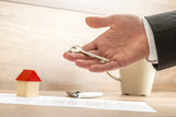 Businessman Holding Key for Real Estate Concept