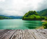 Fototapety Beautiful emerald mountain lake in Switzerland