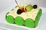 Greentea cake with macaroon and fresh fruit poster