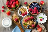 Fresh healthy breakfast with muesli and berries, vitamins, woode