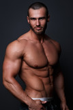 Fototapety Handsome muscular man posing
