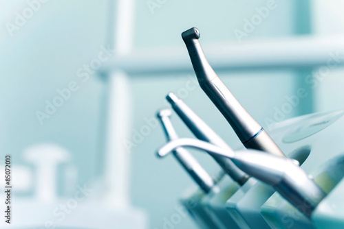 Different dental instruments and tools in a dentists office Plakat