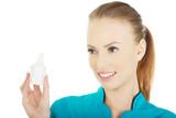 Nurse in uniform with hydrogen peroxide. poster