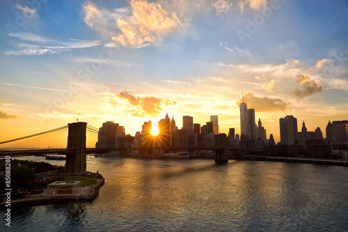 Manhattan skyline and Brooklyn Bridge at sunset, New York