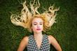 Obrazy na płótnie, fototapety, zdjęcia, fotoobrazy drukowane : Young blonde woman summer day relaxing
