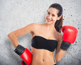 Fototapeta Happy sport woman with boxing gloves