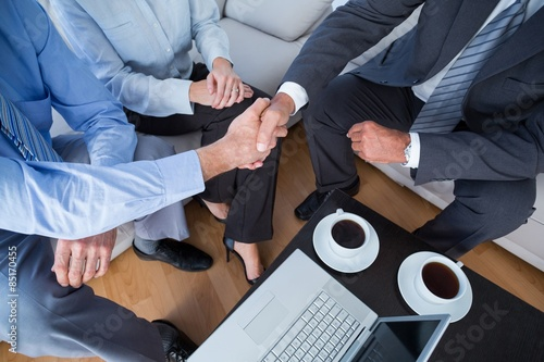 Business people with laptop and hot beverages