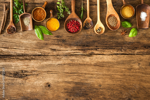 Colorful spices on wooden table