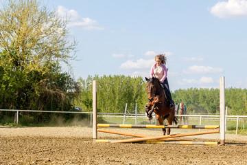 Beautiful girl riding a purebred horse