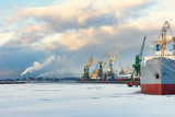 Fototapeta Ship and cranes in the port of winter