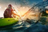Fototapety Young lady paddling hard