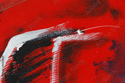 Small part of painted metal wall with black,red and white paint © antova13