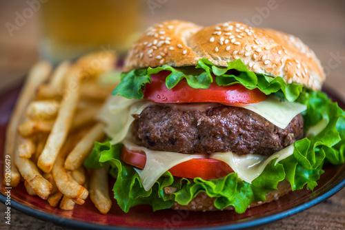 Fototapeta Homemade Hamburger with Fresh Vegetables and French Fries