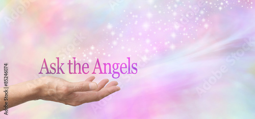 Ask Your Angels for Help - Female hand face up with the words Ask the Angels floating above on a  misty pastel bokeh background and a stream of sparkles flowing from the hand © Nikki Zalewski