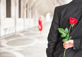 Man waiting for his date with red rose behind his back - Fine Art prints