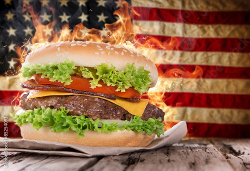Fototapeta Delicious hamburger with fire flames